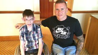 Kieran and David Weir sat next to each other
