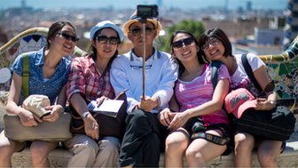 A man taking a selfie with friends