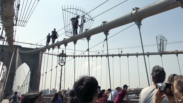 New York Police officers climb the Brooklyn Bridge.