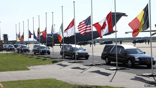 Hearses leave Eindhoven air base. 23 July 2014