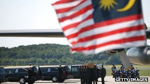 Malaysian flag flies at Dutch coffin carried