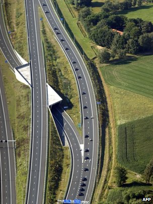 This aerial photo shows a convoy of hearses carrying coffins containing the remains of victims of the downed Malaysia Airlines flight MH17, driving from the Eindhoven Airbase to Hilversum on 23 July 2014.