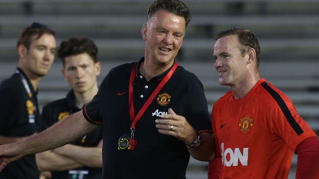 Manchester United manager Louis van Gaal teaches Wayne Rooney how to shoot