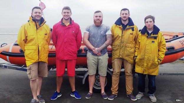 Thomas Redmond (centre) thanks the Port Talbot RNLI crew which saved his life off Aberavon in June 2014