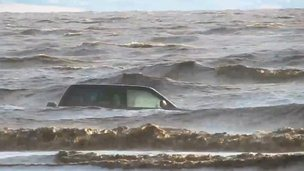 Car floating in the sea after becoming stuck in sinking mud off the Bristol Channel coast