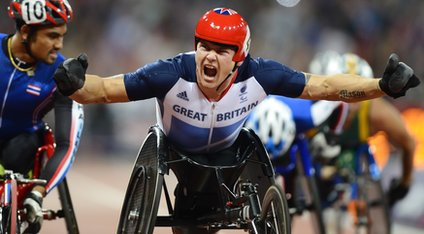 David Weir celebrates as he crosses the finish line