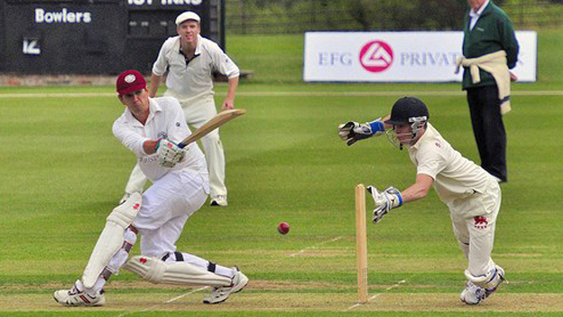 Damien Lewis looks on as Peter Frankopan strikes the ball