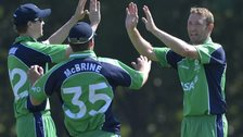 Andrew White celebrates taking a wicket for Ireland against Sri Lanka A