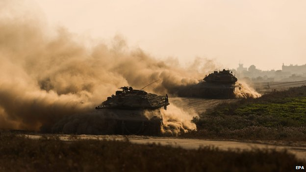 Israel Merkava tanks pull out of the Gaza Strip on 23 July 2014.
