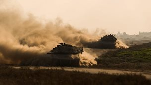 Israel Markava tanks pull out of the Gaza Strip on 23 July 2014.