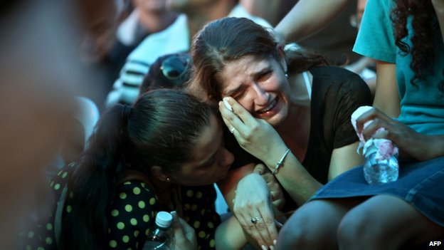 Tal Iluz, the fiance of Natan Cohen, who was killed in an exchange of fire with Palestinian militants inside the Gaza Strip, mourns during his funeral on 23 July 2014, in the central town of Modiin.