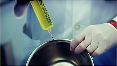 Syringe injecting into a