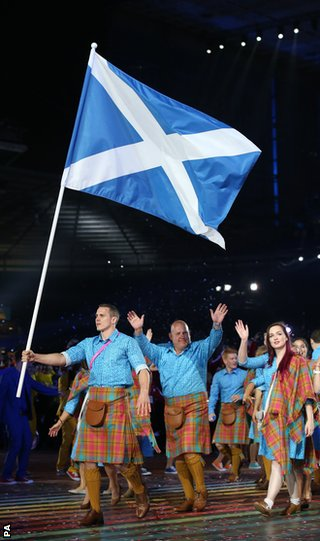 Scotland's Euan Burton carries the flag during the 2014 Commonwealth Games Opening Ceremony at Celtic Par
