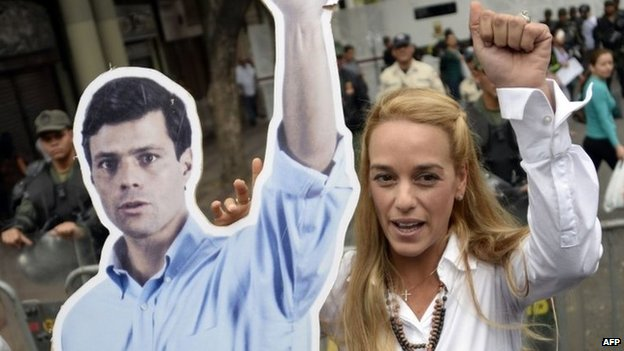 Lilian Tintori holds a poster of her husband, Leopoldo Lopez
