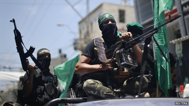"Palestinian members of Hamas"" armed wing take part in the funeral of their comrades in Gaza City June 21, 2014"