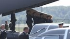 Coffin carried from plane at Eindhoven. 23 July 2014