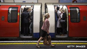 Commuters travel on a crowded Northern Line tube train