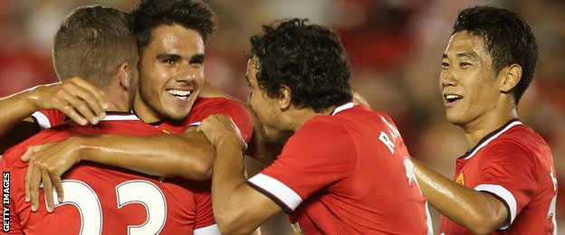 Debutant defender Reece James is congratulated by his Man Utd team-mates after scoring
