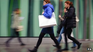 shoppers carrying shopping bags on Oxford Street