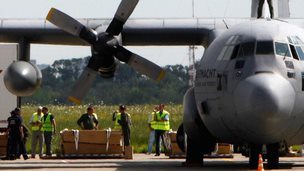 Coffins being loaded onto a Dutch military transport plane in Kharkiv, Ukraine (24 July 2014)