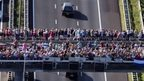 An aerial view taken on July 23, 2014 shows people looking over a bridge the convoy of hearses carrying the bodies of victims of the downed Malaysia Airlines flight MH17 on their way to Hilversum where the bodies will be examine