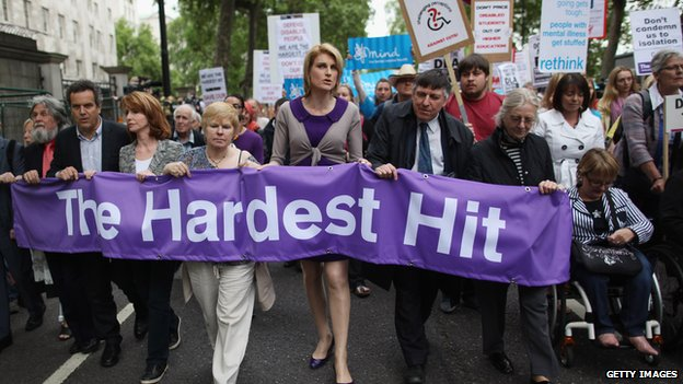 "Campaigners carrying a banner saying ""The Hardest Hit"""