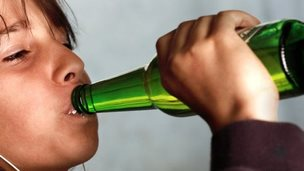 Young person drinking alcohol