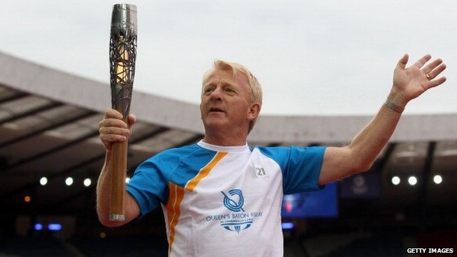 Gordon Strachan carries the Glasgow 2014 Commonwealth Games Queen's Baton at Hampden Park