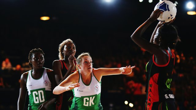 Northern Ireland's netball team defend against a Malawi attack during their opening Pool A game at the 2014 Commonwealth Games in Glasgow