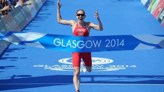 Jodie Stimpson wins gold in the women's triathlon.
