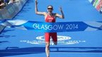 Jodie Stimpson wins gold in the women's triathlon.