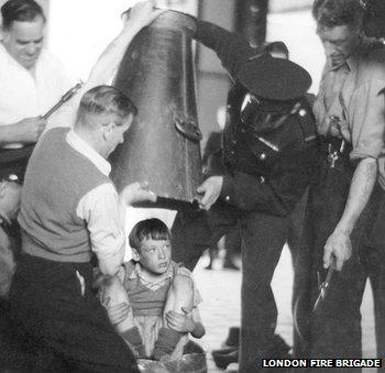 Boy being released from milk churn