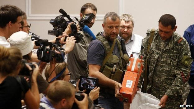 File photo: A pro-Russian separatist shows members of the media a black box belonging to Malaysia Airlines flight MH17, before its handover to Malaysian representatives, in Donetsk, 22 July 2014