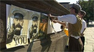 Actors play volunteers posting images of Lord Kitchener