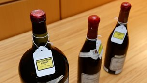 Three bottles of wine used as evidence in the trial of wine dealer Rudy Kurniawan are displayed in Federal Court in New York on 19 December 2013