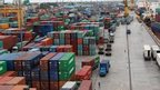 Workers are seen among the containers at Asia World port in Yangon