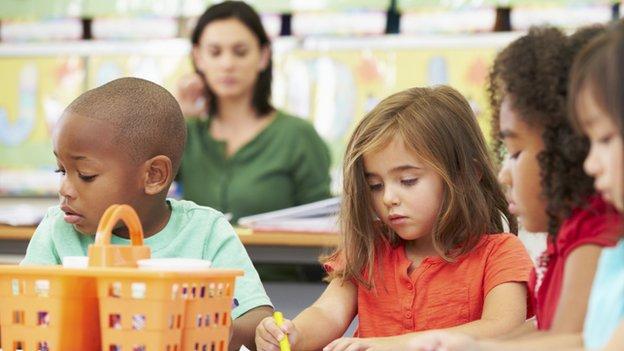 Children play in a preschool classroom.