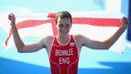 Alistair Brownlee holds aloft a St George's flag