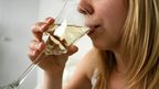 Woman drinking glass of wine