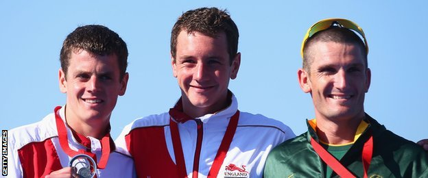 Gold medallist Alistair Brownlee flanked by brother Jonny (left) and South Afirca's Richard Murray