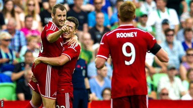 Niall McGinn celebrates after netting Aberdeen's second goal against Groningen