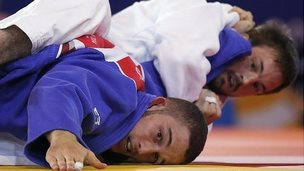 "England""s Colin Oates , rear, pushes down Andreas Karassas from Cyprus to win the Men -66kg Judo final bout at the Commonwealth Games 2014 in Glasgow,"