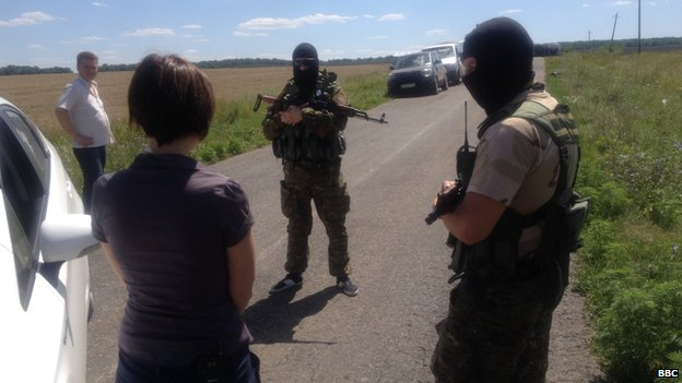 Russian separatists in Ukraine speak to the BBC's Natalia Antelava near the wreckage of the downed MH17, 24 July 2014