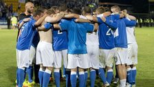 St Johnstone players go in to a huddle after securing their place in the next round of the Europa League