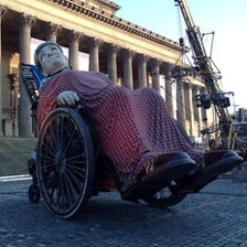 Grandma sleeping in front of St Georges Hall