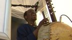 A man performing at the Black Cultural Archives