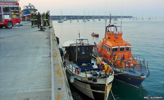 Alderney lifeboat with trawler and fire service in Braye Harbour