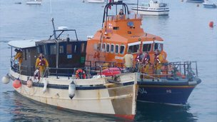 Alderney lifeboat towing trawler into Braye Harbour