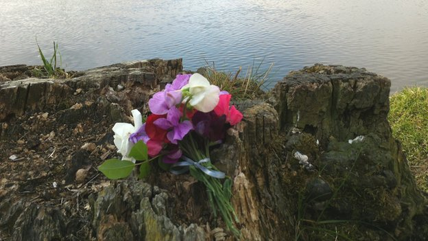 Tribute left on riverbank