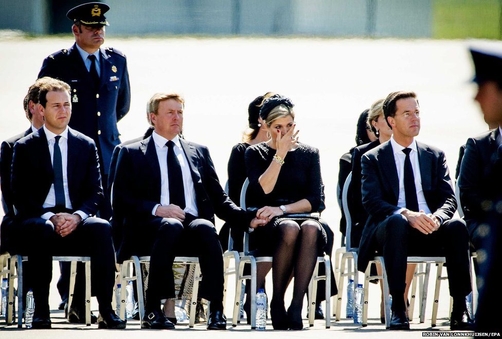 Dutch Deputy Prime Minister Lodewijk Asscher, Dutch King Willem-Alexander, Queen Maxima and Dutch Prime-Minister Mark Rutte at the airbase in Eindhoven, The Netherlands